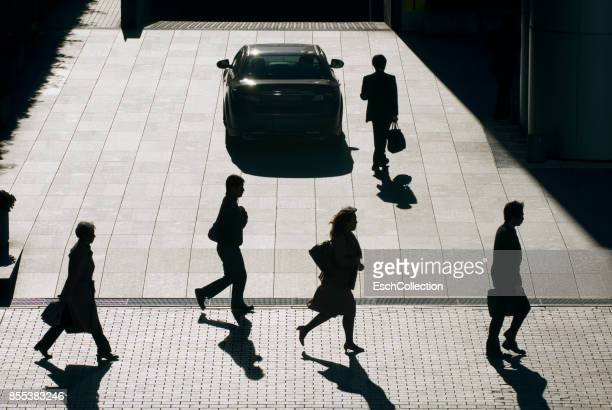 Silhouettes of business people going to work