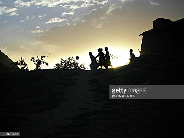 Silhouettes of children playing game
