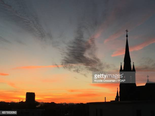 Silhouettes of church at sunrise