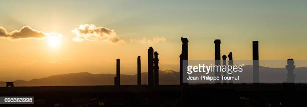 silhouettes of columns in persepolis during sunset, near shiraz, fars province, iran - ancient history stock pictures, royalty-free photos & images