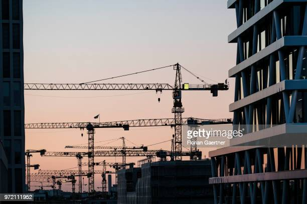 Silhouettes of cranes are pictured on May 29 2018 in Berlin Germany