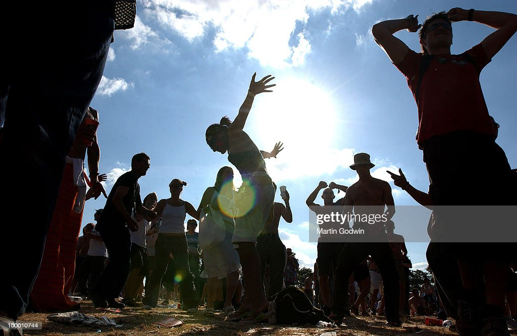 Silhouettes of dancers in the sun at the Radio 1 dance stand at Glastonbury, 28th June 2003.