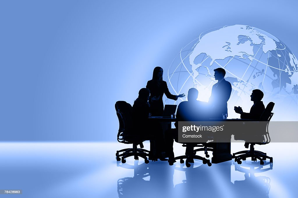Silhouettes of global business people meeting : Stock Photo