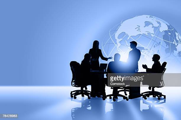 Silhouettes of global business people meeting