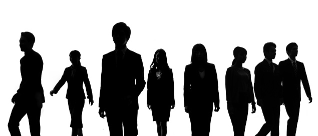 Silhouettes of group of businessperson. 1160158031