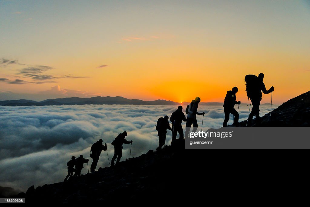 Silhouettes of hikers At Sunset : Stock Photo