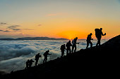 Silhouettes of hikers At Sunset