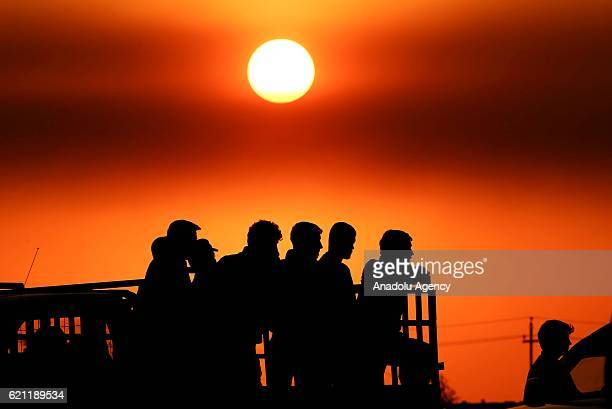 Silhouettes of Iraqis fled from Kokchali and other neighborhoods are seen as they move forward to Khazir Region during the operation to retake Iraq's...
