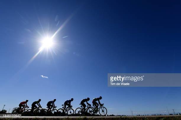 Silhouettes of Juri Zanotti of Italy and Bardiani Csf Faizane Team, Oier Lazkano Lopez of Spain and Team Caja Rural-Seguros RGA, Mattia Frapporti of...