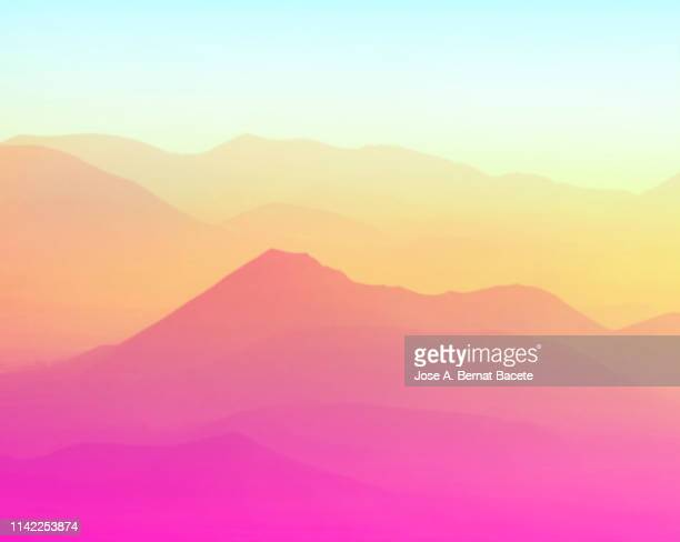 silhouettes of mountains between covered valleys of fogs and hazes to the dawn of a day of golden light. spain. - 雰囲気 ストックフォトと画像