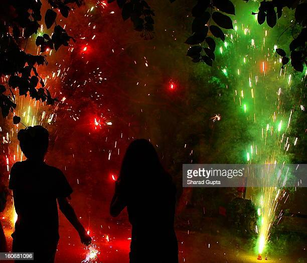 Silhouettes of my son and daughter, enjoying the sparkling fire fountain they lit. Diwali is a major Hindu festival. This year it was celebrated on...