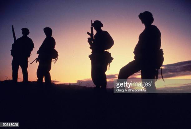 Silhouettes of Navy SEAL team, part of US Special Forces.