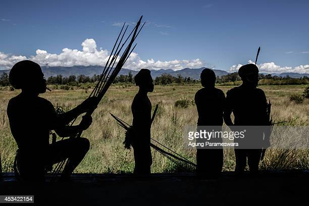 Silhouettes of Papuanese tribal men during the 25th Baliem Valley festival on August 8, 2014 in Wamena, Indonesia. The Baliem Valley Cultural...