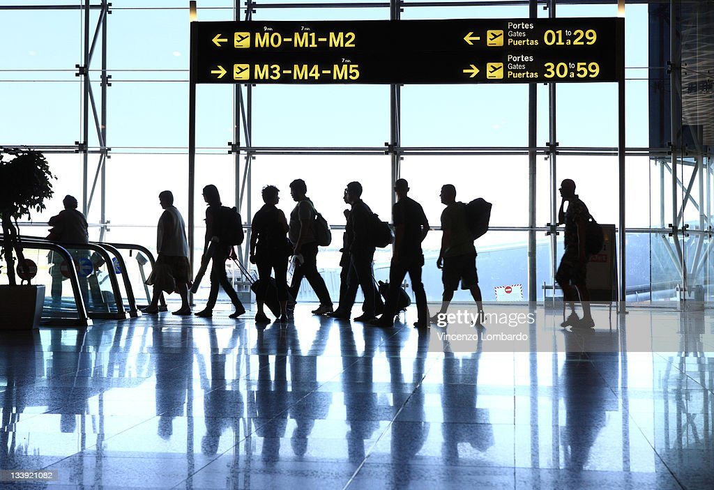 Silhouettes of passengers in airport : Stock Photo
