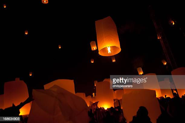 Silhouettes of people and dim lighting at Loi Krathong