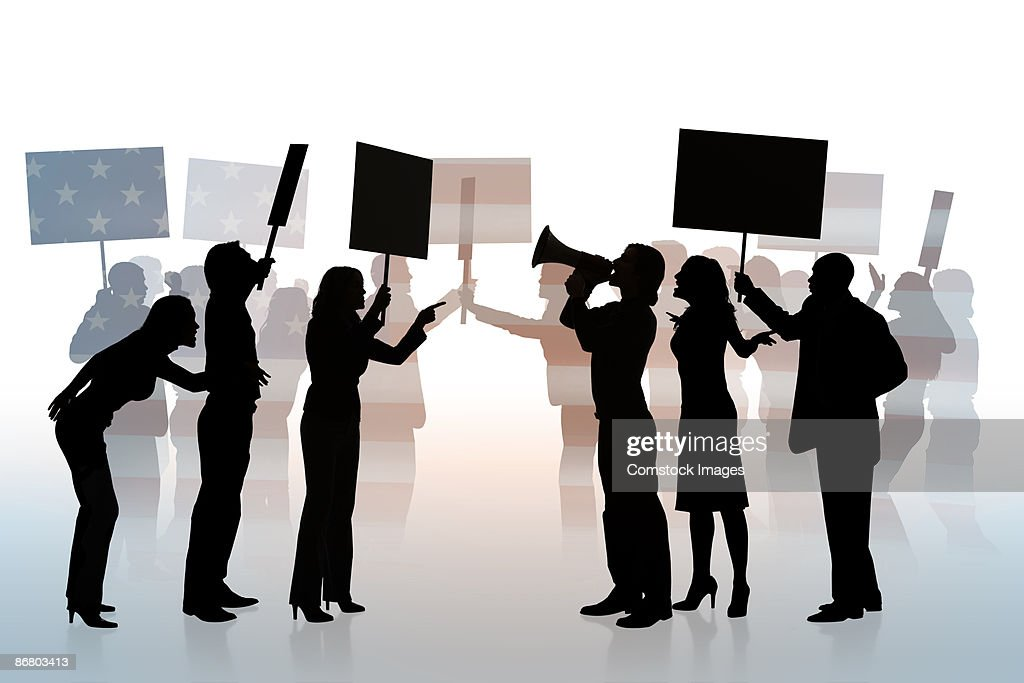 Silhouettes of people at political protest : Stock Photo