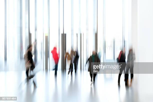 silhouettes of people in a modern interior - bokeh museum stock photos and pictures