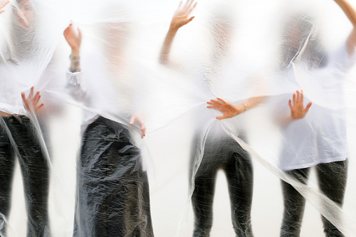 Silhouettes of people in black and white clothes behind a translucent veil - gettyimageskorea