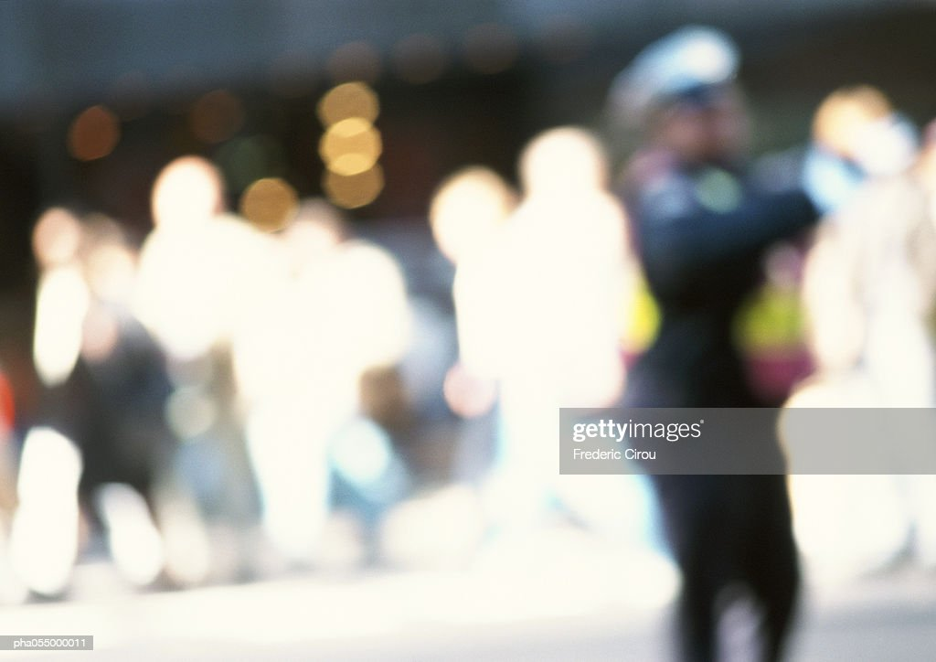 Silhouettes of people in street, blurred : Stockfoto