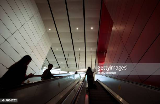 Silhouettes of people on moving escalator in Hong Kong