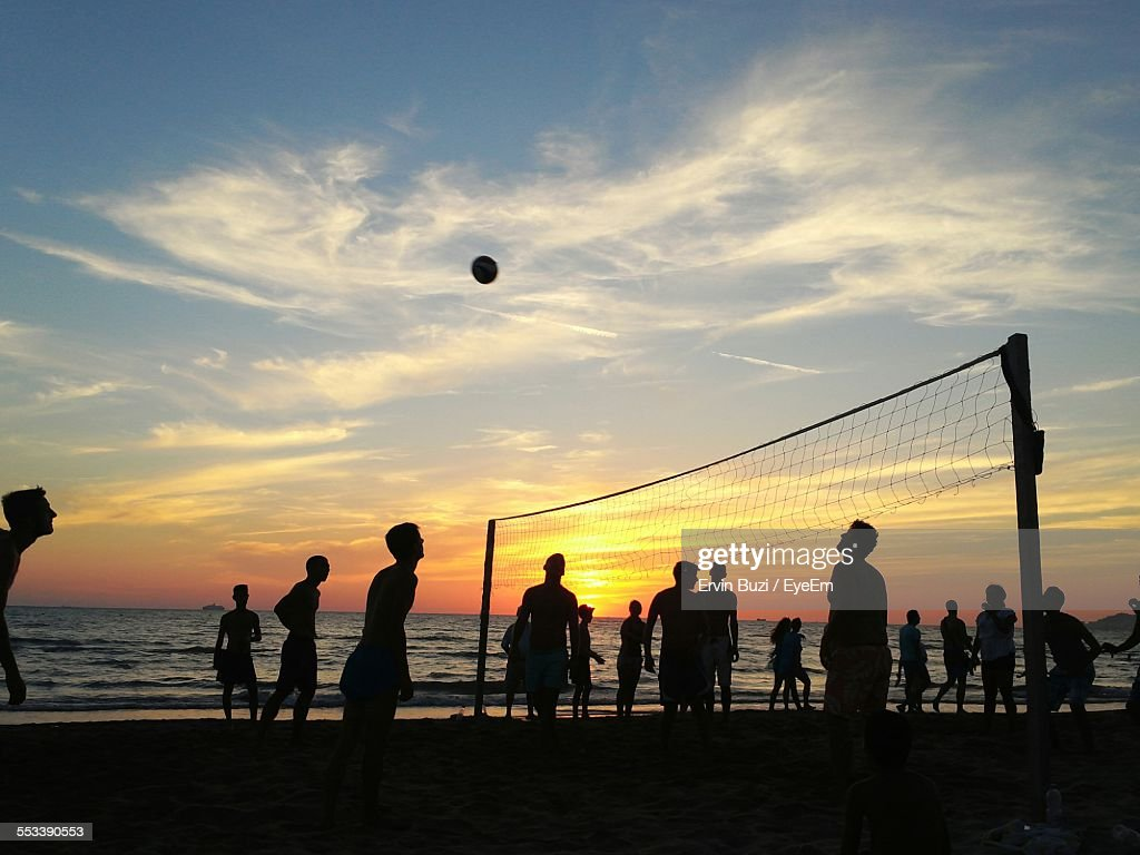 Silhouettes Of People Playing Beach Volleyball : Stock Photo