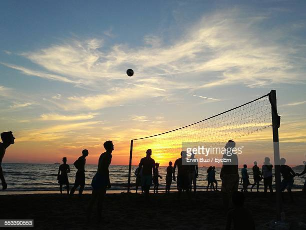 Silhouettes Of People Playing Beach Volleyball