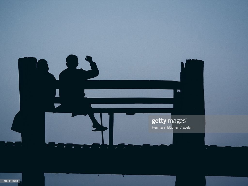 Incredible Silhouettes Of People Sitting On Wooden Bench High Res Stock Bralicious Painted Fabric Chair Ideas Braliciousco