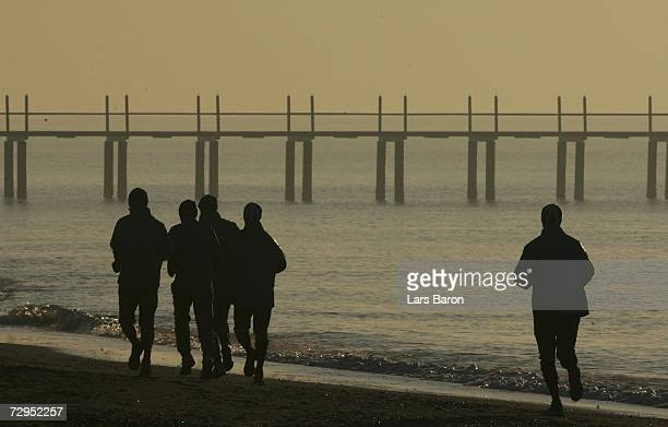Silhouettes of players are seen as they jog on the beach during the Werder Bremen training camp on January 09 2007 in Belek near Antalya Turkey