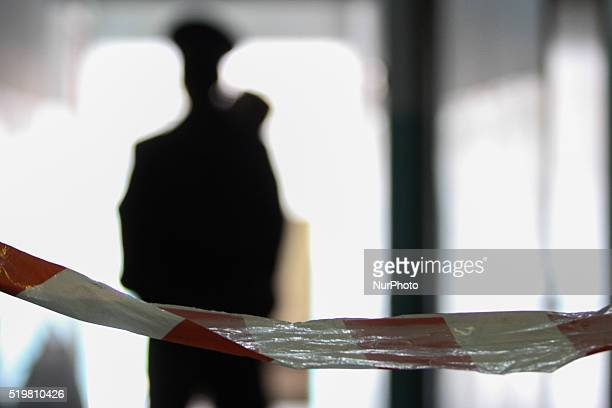 Silhouettes of Police officers guarding the entrance of Judge Didyk office are seen in the picture On April 8 2016 unidentified persons threw a...