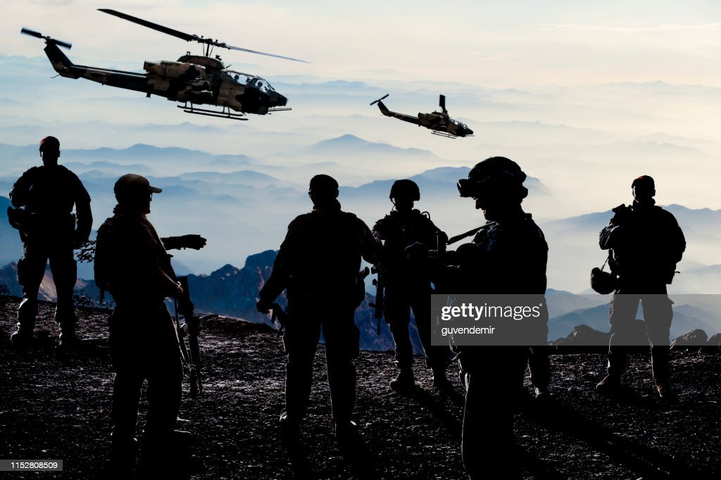 Silhouettes of soldiers during Military Mission at dusk : Stock Photo
