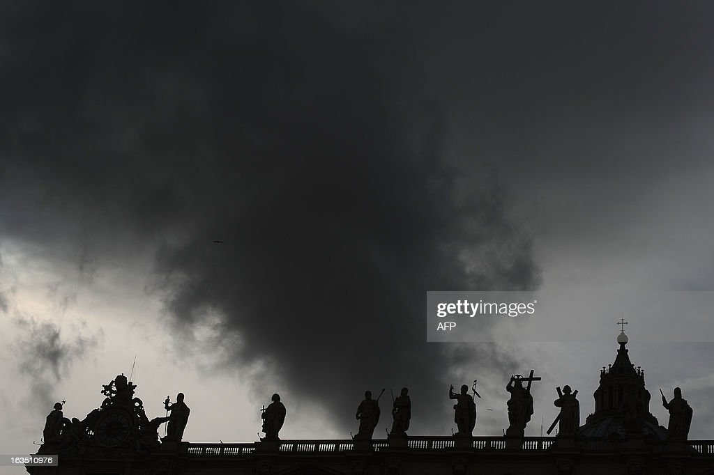 Silhouettes of statues on the colonnade at St Peter square ahead of the conclave on March 11, 2013 at the Vatican. Catholic cardinals had a final day of jockeying for position the same day before shutting themselves into the Sistine Chapel to elect a new pope after Benedict XVI's shock resignation, with an Italian and a Brazilian who both head powerful archdioceses among the top contenders.