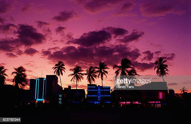 silhouettes of the art deco district of miami beach - miami beach stock pictures, royalty-free photos & images
