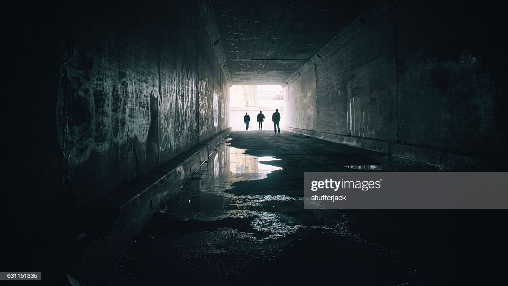 Silhouettes Of Three People In Sixth Street Tunnel Los Angeles