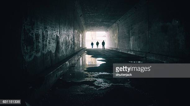 Silhouettes of three people in Sixth Street Tunnel, Los angeles, California, America, USA