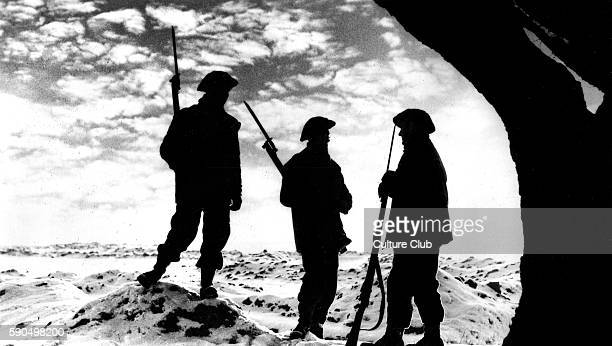 WWII Silhouettes of three soldiers with bayonets in the snow Western Front Caption reads ' The Watch goes on Sunset on the Western Front but still...