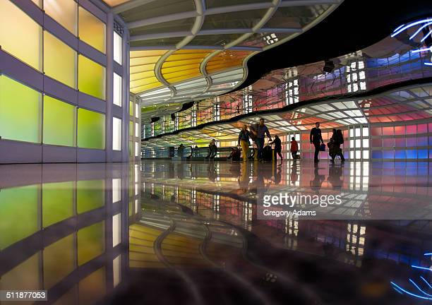 silhouettes of travelers in an airport concourse - ohare airport stock pictures, royalty-free photos & images