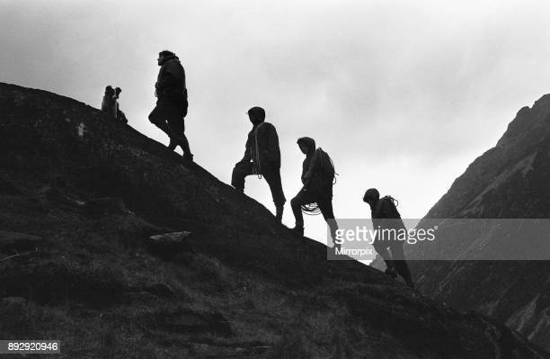 Silhouettes on Snowdon 20th April 1964 John Rees Jones of the Outdoor Pursuits Centre at Hafod Meurig leads a group of boys from the Rainer...