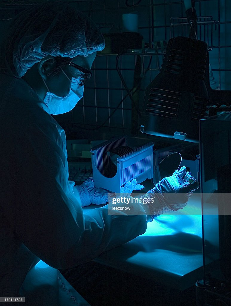 Semiconductor Stock Photos And Pictures Getty Images Circuitboardmachinewithtechnician Commercial Editorial Silicon Wafer Inspection Under Blue Light