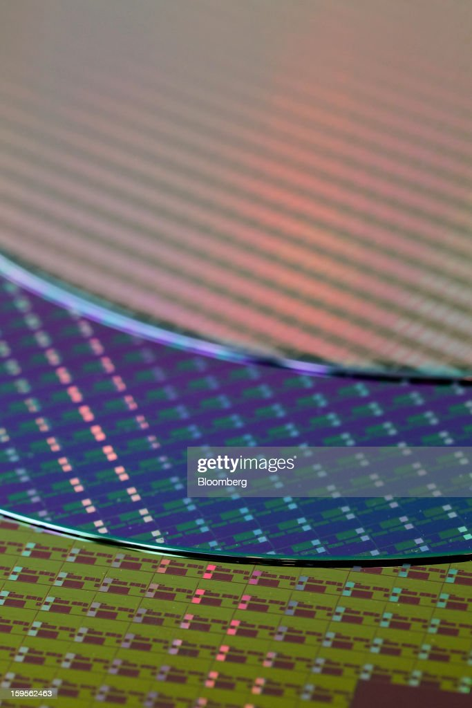 Silicon wafers made by Taiwan Semiconductor Manufacturing Co. (TSMC) are arranged for a photograph at the company's headquarters in Hsinchu, Taiwan, on Wednesday, Jan. 16, 2013. Taiwan Semiconductor Manufacturing Co., the world's largest supplier of made-to-order chips, is scheduled to announce company results tomorrow. Photographer: Maurice Tsai/Bloomberg via Getty Images