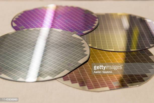 silicon wafers with a pattern on surface multiple colors stacked together - wafer processing machine stock photos and pictures