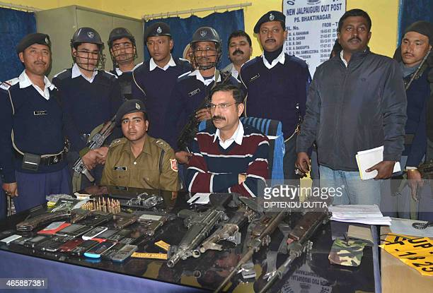 Siliguri Police Commisioner Jag Mohan speaks with journalist while seized weapons are displayed during a news conference at the NJP outpost in...