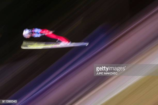 TOPSHOT Silje Opseth of Norway competes in the FIS Ski Jumping World Cup Ladies Normal Hill Individual event in Ljubno on January 28 2018 / AFP PHOTO...