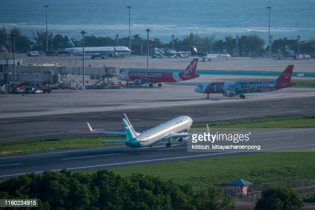 silk air taking off at phuket international airport - off stock pictures, royalty-free photos & images