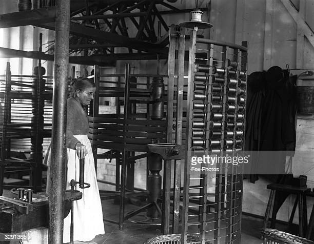 Silk bobbins in the looms used for making tapestries at the works in Braintree, Essex.