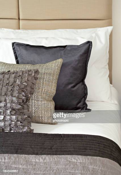 silk cushions and white sheets