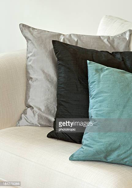 silk cushions on a settee