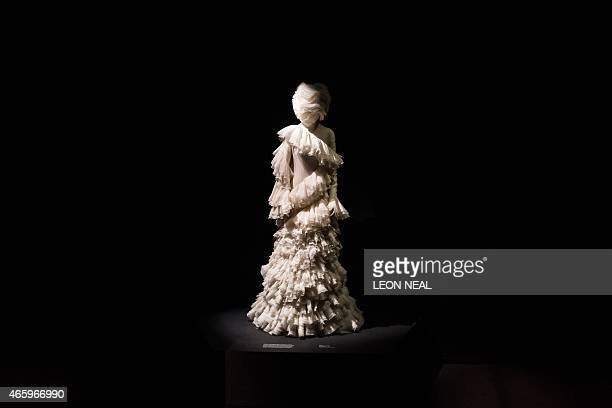 A silk dress from 'The Widows of Culloden' Autumn / Winter 2006 collection is on display during a press preview of Alexander McQueen's 'Savage...
