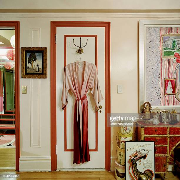Silk dressing gown hanging on a closet door in socialite and heiress Gloria Vanderbilt's bedroom is photographed for Town & Country Magazine on...