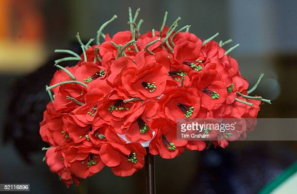 """Silk Flowers Hat By Milliner Simone Mirman Worn By Queen Elizabeth II For A Visit To Morocco On Display At The Exhibition """"hats And Handbags -..."""