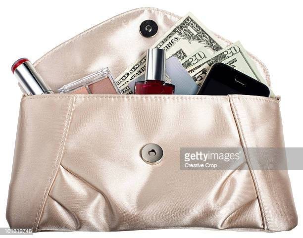 Silk purse containing mobile phone lipstick money